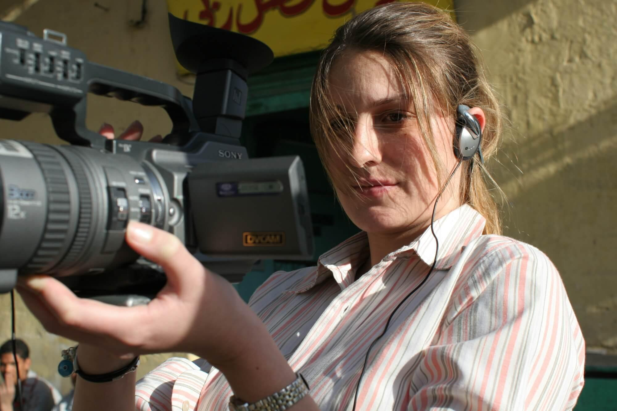 girl holding a video camera