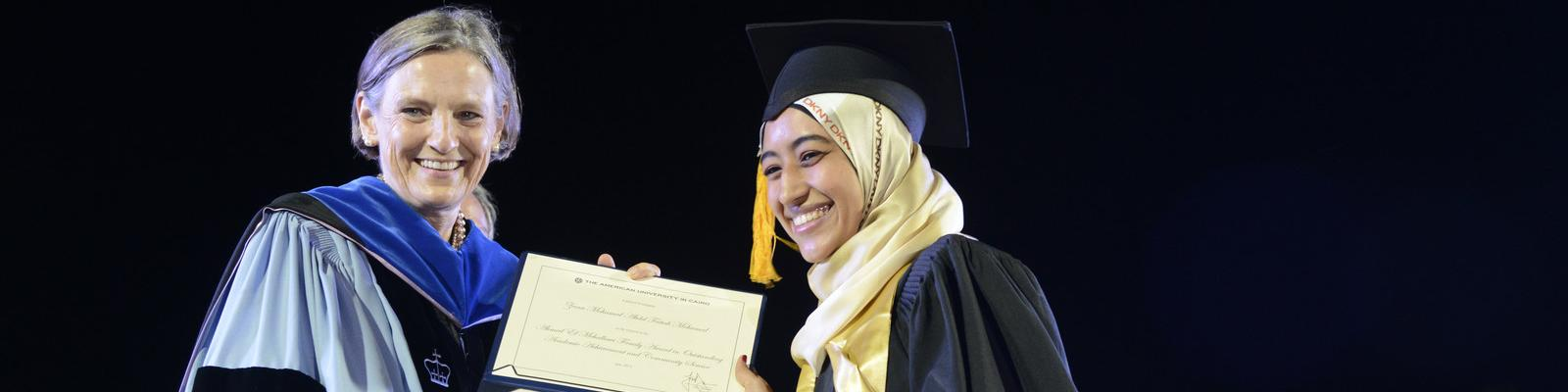 student receiving an award during a ceremony