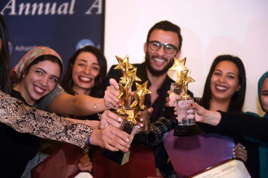 group of male and female students holding trophies